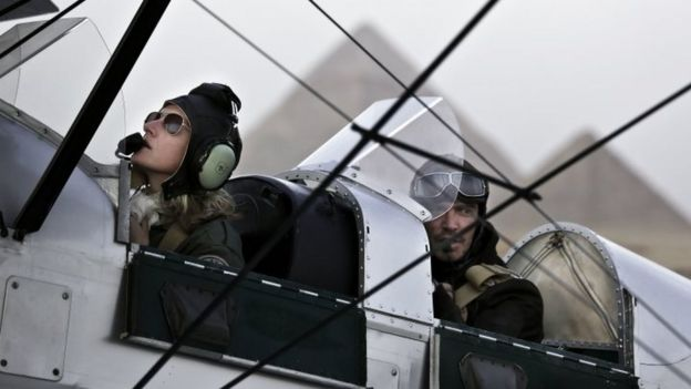 Belgian pilot Alexandra Maingard, (left) and her husband, Belgian commercial pilot Cedric Collette, right, prepare for take off during a rally across Africa, at the Giza Pyramids in Egypt (13 November 2016)