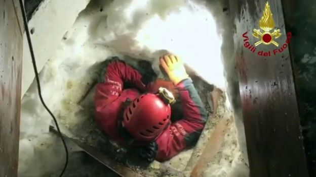 A firefighter in an opening at the Rigopiano hotel, Italy, 22 January