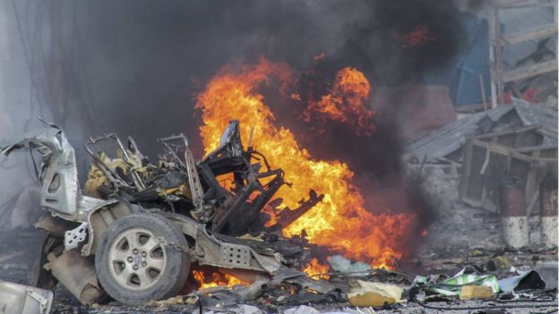 A vehicle burns after a car bomb exploded in front of the Sahafi Hotel in Mogadishu