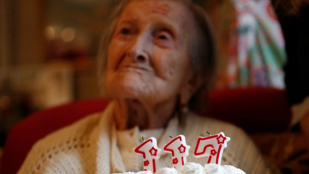 Ms Morano is pictured behind a cake with candles marking 117 years in the day of her birthday