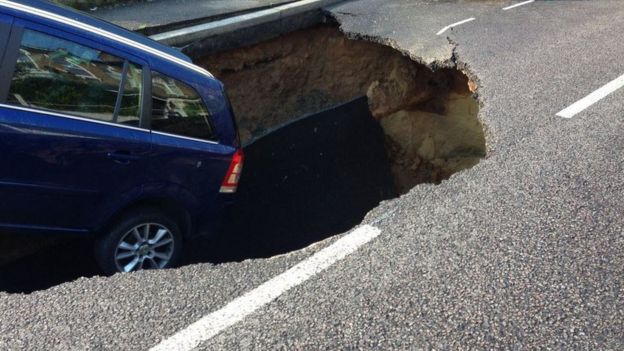 Car in hole