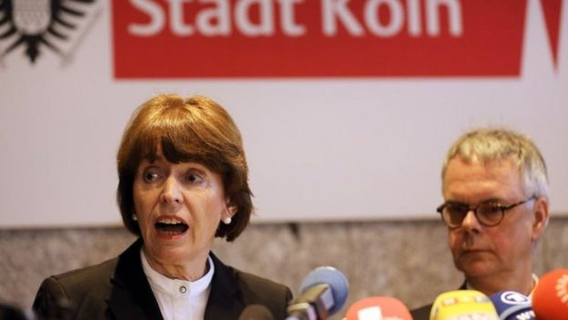 Cologne mayor Henriette Reker , left, and the head of Cologne