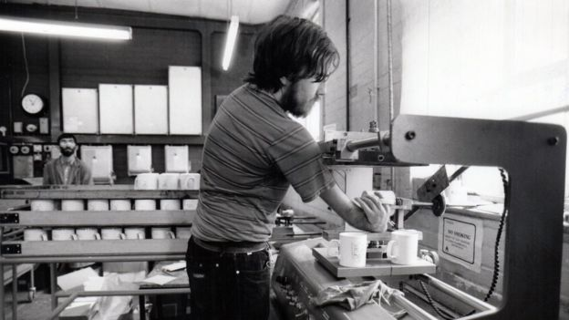 A man making mugs, his hand turns back on itself