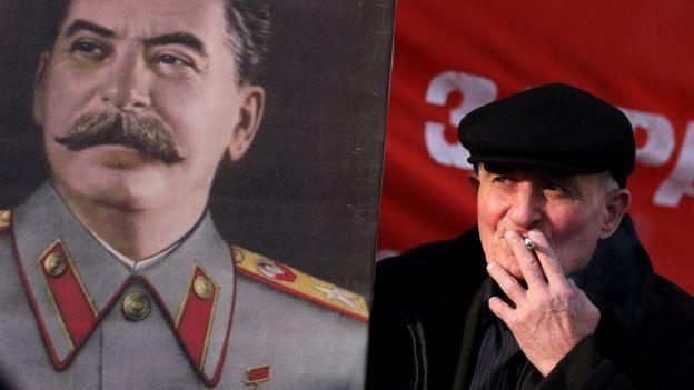 Hombre con foto de Stalin