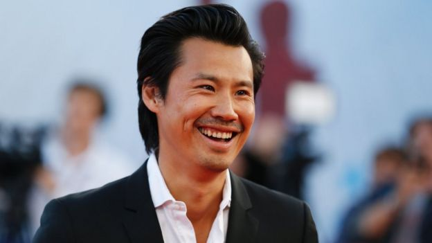 French actor Frederic Chau poses on the red carpet on September 9, 2016 in the northwestern sea resort of Deauville, as part of the 42nd Deauville US Film Festival