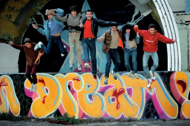 Duro, Doze, Mare 139, Shy 147, Daze, Lady Pink, and Crash jumping off the East River Park amphitheatre, Manhattan, 1981