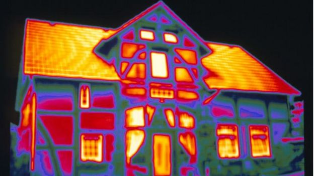 Thermal image showing heat loss from a house