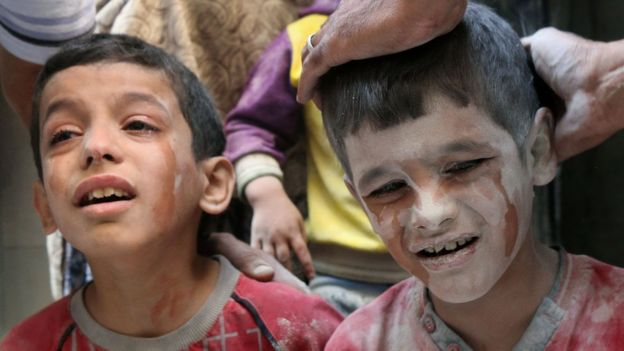 Young boys crying after air strikes in eastern Aleppo - 11 October