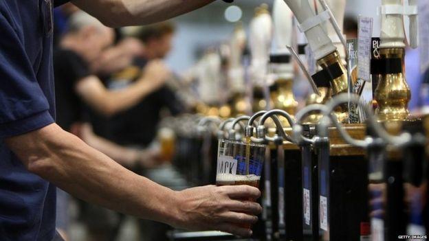 Bartender pulls pint of beer