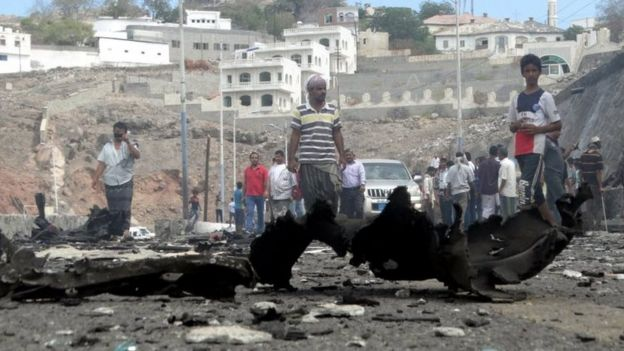 People gather at the site of the car bomb attack