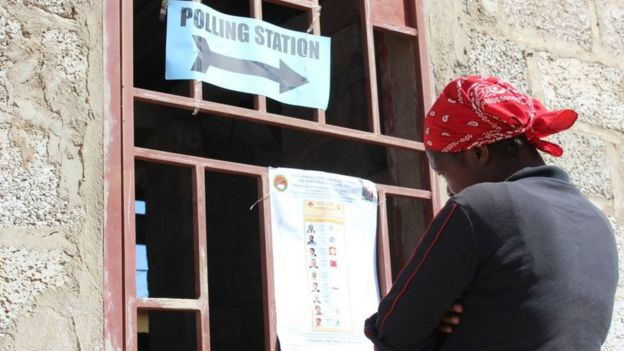 A voter in Zambia looking at a list of candidates at a polling station in Lusaka