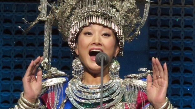 Song Zuying performs during the