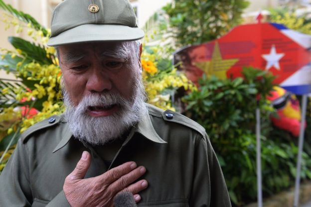 Vietnamese veteran Nguyen Van Hai, 70, cries as he speaks of his feelings after paying tribute to the Cuban leader Fidel Castro at the Cuban embassy in Hanoi on December 4, 2016.
