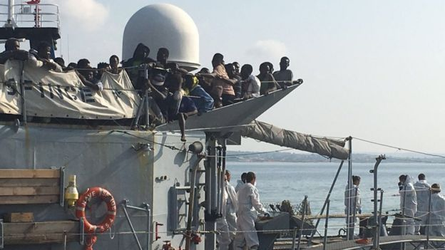 Hundreds of migrants arrive at Pozzallo in Sicily on a Navy ship