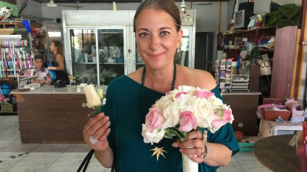 Wedding planner holding a bride's bouquet
