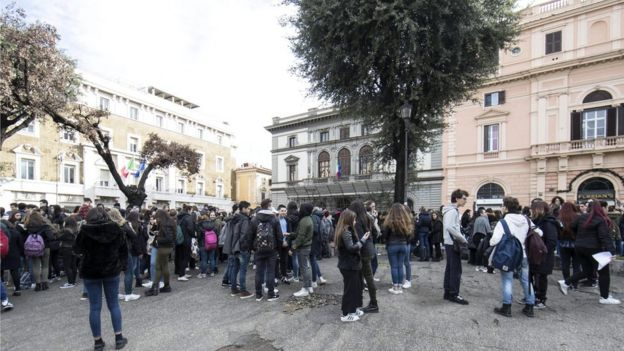 Students and teachers stand outside Machiavelli school after a 5.6 magnitude earthquake struck in Rome, Italy, on 18 January 2017