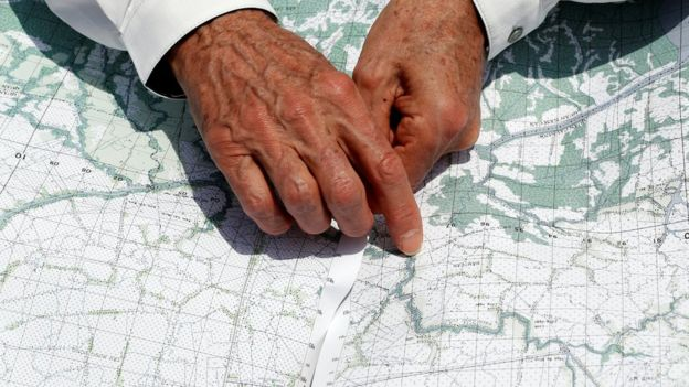 US Secretary of State John Kerry uses a map to pinpoint where the ambush took place in Vietnam