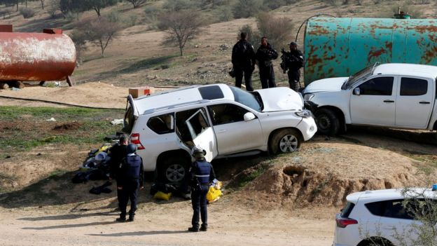A car (L) that Israeli police said was used by an Arab Israeli to ram into a group of policemen in Umm al-Hiran on 18 January 2017