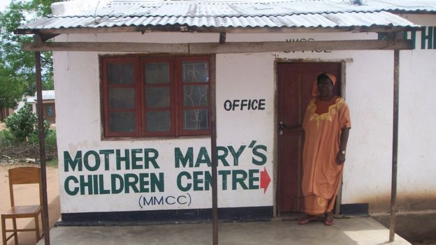 Mary Mangwiza outside Mother Mary's Children Centre in Malawi