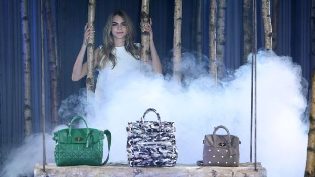 Cara Delevingne with Mulberry bags