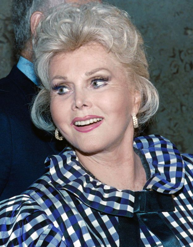 This file photo taken on July 12, 1989 shows US actress Zsa Zsa Gabor exiting the Beverly Hills Municipal Court on July 12, 1989 where she appeared in order to answer charges of battery against a police officer.