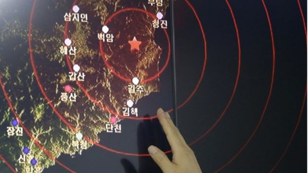 In this Friday, Sept. 9, 2016, file photo, an official of the Earthquake and Volcano of the Korea Monitoring Division points at the epicentre of seismic waves in North Korea, in Seoul, South Korea.