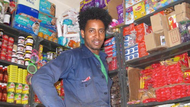 Shopkeeper selling imports
