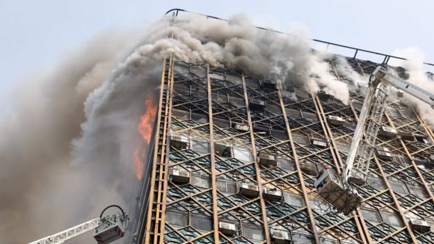 Smoke pours from the Plasco building in Tehran, Iran, shortly before it collapses (19 January 2017)