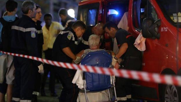 Emergency workers help an injured woman in Nice