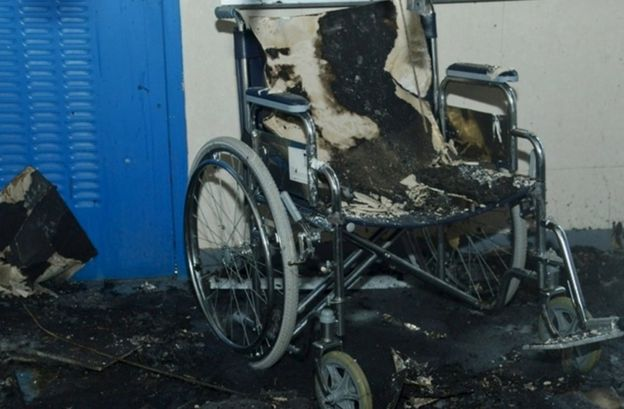 A wheelchair badly burnt in a fire at a hospital in Saudi Arabia