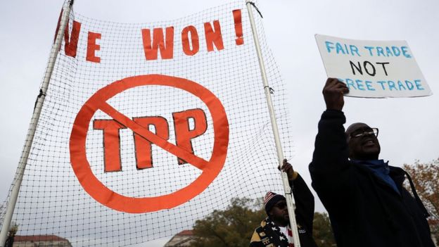 Activists shout slogans as they march during an anti-Trump and anti-TPP protest November 14, 2016 in Washington, DC. Activists held a rally and a march