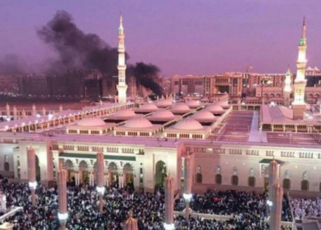 Smoke rises behind the Prophet's Mosque in Medina
