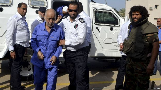 Baghdadi al-Mahmoudi, former prime minister of Libya, arrives for a hearing at a courtroom in Tripoli on 19 September 2013