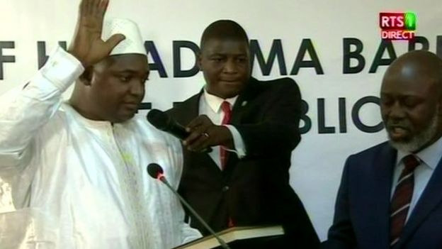 Adama Barrow (left) during his swearing in ceremony