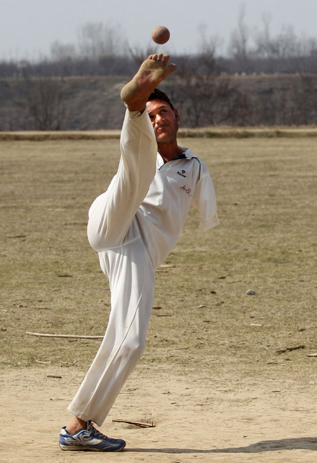 Amir bowls with his foot
