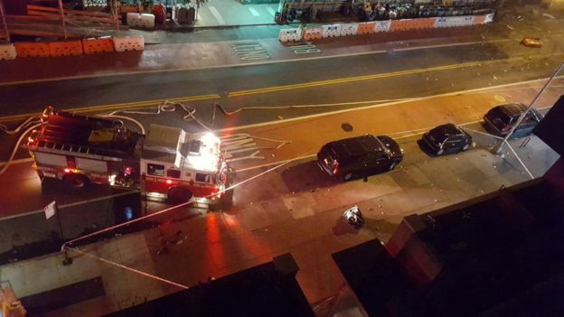 Fire rescue crews block off the street near the scene of an explosion in the Chelsea, New York, on 17 September 2016