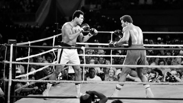 This file photo taken on October 30, 1974 shows Former world heavyweight champion Muhammad Ali (L) and titleholder US George Foreman (R) fighting on October 30, 1974 in Kinshasa, Zaire