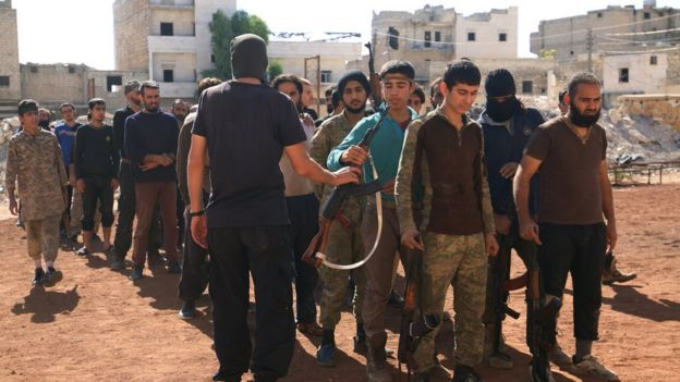 Rebel fighters part of the Jabhat Fateh al-Sham, attend military training in the besieged rebel held Aleppo