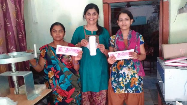 Swati Bedekar (centre) with two women who make sanitary pads