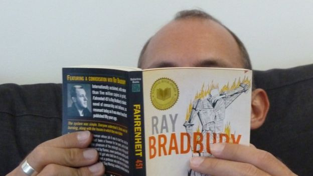 Man reading Ray Bradbury book