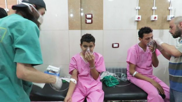 UGC image shows civilians in hospital gowns with breathing masks, reportedly after a Chlorine attack in a suburb of Aleppo, Tuesday 6 September 2016