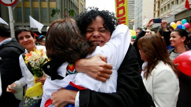 Women in Bogota hug as they celebrate the signing of a historic ceasefire deal between the Colombian government and FARC rebels, 23 June 2016.