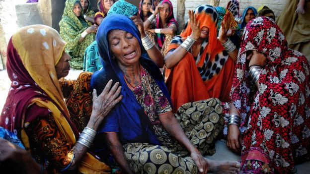 Pakistani Hindu women mourn the deaths of their family members in Tando Muhammad Khan near Hyderabad, Tuesday, March 22, 2016