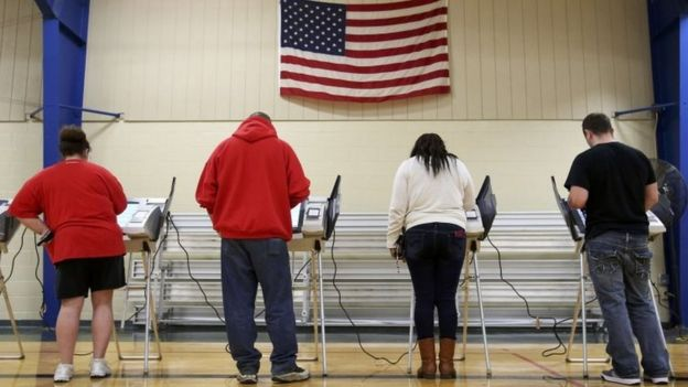 Voters cast their votes during the US presidential election in Elyria, Ohio, on 8 November.
