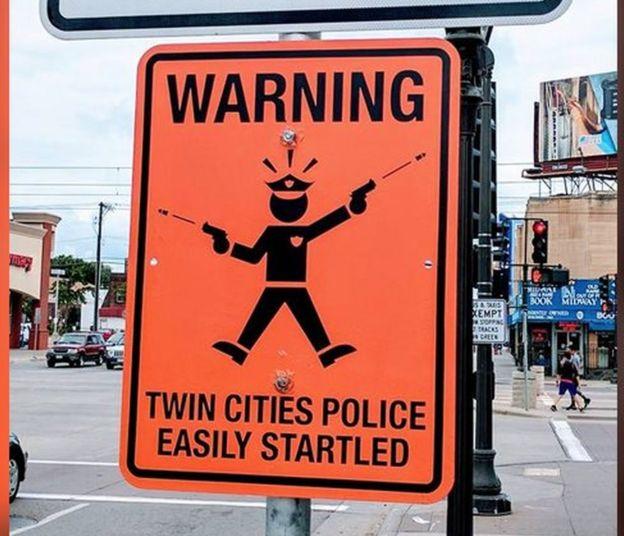 sign mocking police