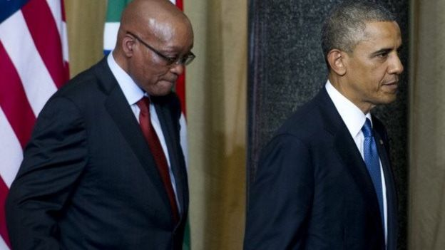 South African President Jacob Zuma (L) and US President Barack Obama leave following a joint press conference at the Union Building in Pretoria, on 29 June 2013.