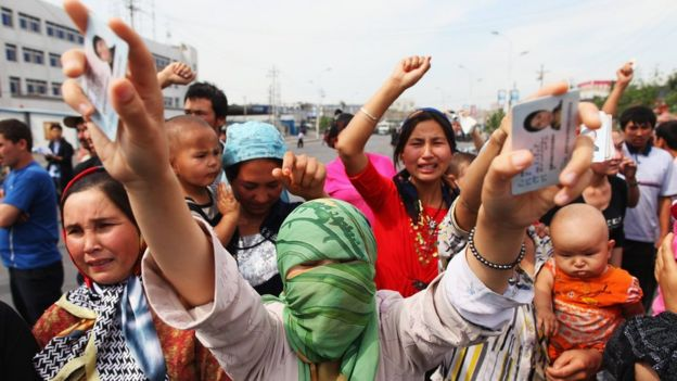 Uighur women protest against the detention of their relatives on a street in Urumqi, the capital of Xinjiang region, on 7 July 2009.