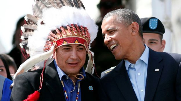 U.S. President Barack Obama talks to the Standing Rock Sioux Tribe Chairman David Archambault II (L) as they attend the Cannon Ball Flag Day Celebration at the Cannon Ball Powwow Grounds on the Standing Rock Sioux Reservation in North Dakota, June 13, 2014