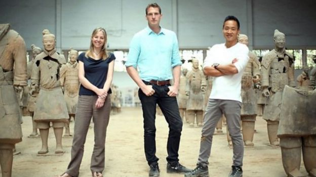 BBC presenters standing in the middle of the Terracotta Army