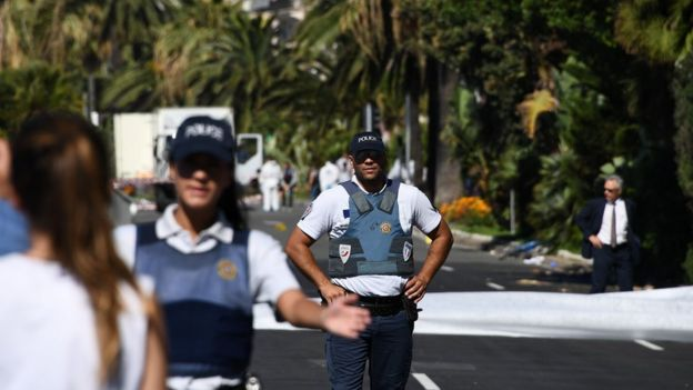 Policemen stand guard the Promenade des Anglais seafront in the French Riviera town of Nice on 15 July 2016